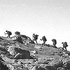 Wandering climbers on a ridge of Ben Mor in Scotland