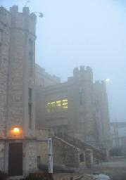 The Gothic castle-like structure of Saint Olaf College, on a slighty foggy day for mysterious mood effect.
