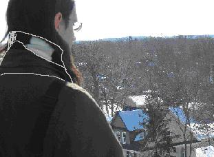Sean looking out over Northfield from atop the Chapel. You might wonder how we got such a high view over Carleton?