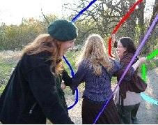 Carleton students frolicking around the maypole.